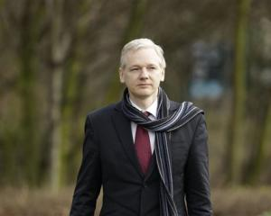 Julian Assange arrives for his extradition hearing at Belmarsh Magistrates' Court in London.  (AP...