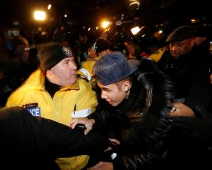 Justin Bieber arrives at a police station in Toronto where he was charged with assaulting a...