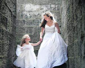 Kate Anderson and her flower girl at her January wedding. KELK PHOTOGRAPHY.