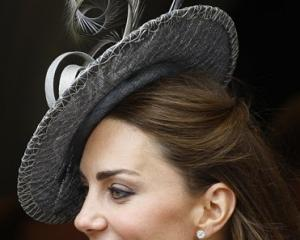 Kate, Duchess of Cambridge watches the procession pass at the Order of The Garter Service in...