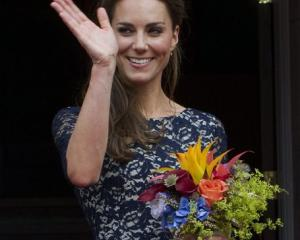 Kate, Duchess of Cambridge waves to the crowd at a ceremony at Rideau Hall in Ottawa, Ontario.  ...
