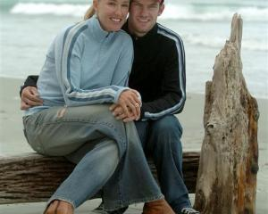 Katie Mactier and Greg Henderson relax at St Clair Beach in this 2005 picture. Photo by Craig...