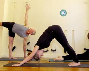 Ken Allison, Lisa Morrison and Emma Furness of the Dunedin Yoga Studio demonstrate a range of...