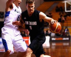 Kirk Penney takes the ball forward for the Tall Blacks against South Korea. (Photo by Phil Walter...