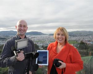 Kyle and Tania Elmer,  of Mana Property Management, with an i-Phone video rig which they use for...