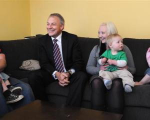 Labour leader Phil Goff (centre) with members of the Campbell family, from left, Jesse-James (2),...