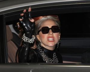 Lady Gaga waves upon her arrival at Don Muang Airport for her concert in Bangkok, Thailand....