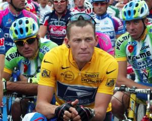 Lance Armstrong of the US waits in front of the pack of riders for the start of the 89th Tour de...