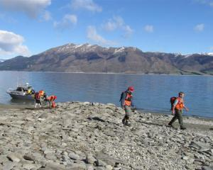 LandSAR Wanaka search and rescue volunteers Peter Reed (left) and John Burke head off along the...