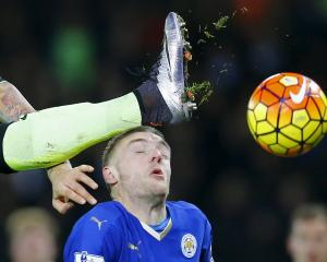 Leicester City's Jamie Vardy avoids the boot of Manchester City's Nicolas Otamendi. Photo Reuters