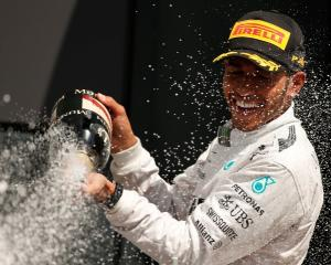 Lewis Hamilton sprays Champagne as he celebrates winning the British Grand Prix at the...