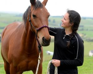 Lexie Elliott with her horse Jay in the paddock at home in Palmerston. Photo by Linda Robertson.