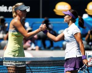 Li Na of China (R) shakes hands with Maria Sharapova of Russia after defeating her in their women...