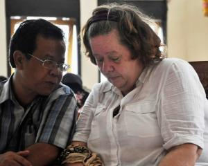 Lindsay Sandiford listens to her translator during her trial in Denpasar in Bali. REUTERS/Stringer