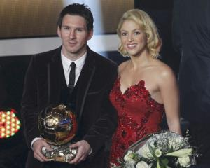 Lionel Messi of Argentina, FIFA World Player of the Year holds his FIFA Ballon d'Or 2011 trophy...