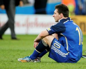 Lionel Messi reacts after Argentina's World Cup final loss to Germany. REUTERS/Sergio Moraes
