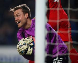 Liverpool goalkeeper Simon Mignolet saves a shot from Blackburn's Simon Eastwood. Photo: Action...