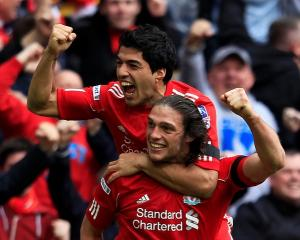 Liverpool's Andy Carroll (bottom) celebrates his goal against Everton with teammate Luis Suarez...