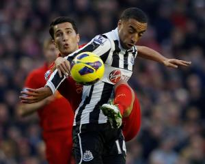 Liverpool's Nuri Sahin (L) challenges Newcastle United's James Perch during their English Premier...