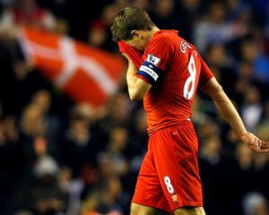 Liverpool's Steven Gerrard leaves the pitch after his team lost to Swansea in their English...