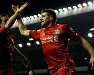 Liverpool's Steven Gerrard (R) celebrates scoring against Everton with teammate Jordan Henderson...