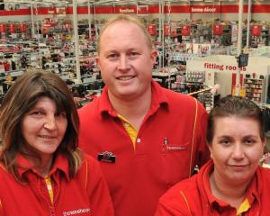Long-serving  staff members of  The Warehouse (from left) Sharon Giggins, Gareth Michelle and...