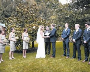 Lucinda Borrie and Chris Garside exchange vows at Grandview Gardens in Febraury. Photo by Kerry...