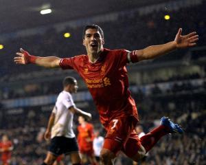 Luis Suarez celebrates after scoring against Tottenham Hotspur at White Hart Lane in London....