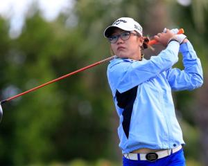 Lydia Ko follows her tee shot on the fourth hole. Photo Getty Images