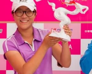 Lydia Ko poses with the trophy after her win. Photo Getty Images