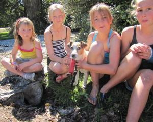 Macca is reunited with the Gibson sisters (from left) Holly (6), Alyssa (11) and Caitlin (10) and...