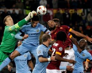 Manchester City goalkeeper Joe Hart (L) makes a save during their Champions League match against...
