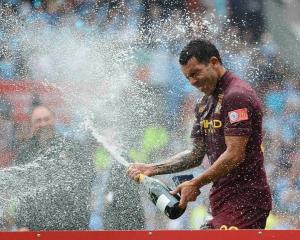 Manchester City's Carlos Tevez celebrates his team's victory over Chelsea in their English...