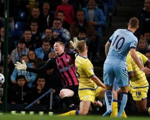 Manchester City's Edin Dzeko (2nd R) scores past Sheffield Wednesday goalkeeper Chris Kirkland....