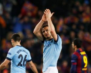 Manchester City's Frank Lampard applauds fans at the end of the match against Barcelona at the...