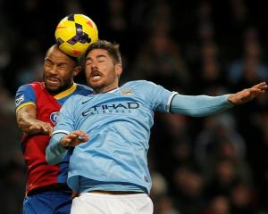 Manchester City's Javi Garcia (R) and Crystal Palace's Danny Gabbidon contest the ball. REUTERS/Phil