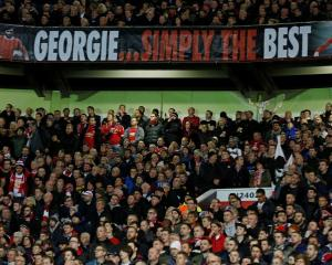 Manchester United fans pay tribute to George Best during the match against PSV Eindhoven. Photo...
