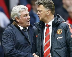 Manchester United manager Louis van Gaal (R) welcomes his Hull City counterpart Steve Bruce...