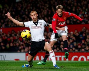 Manchester United's Adnan Januzaj (R) challenges Fulham's Steve Sidwell. REUTERS/Darren Staples