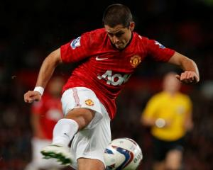 Manchester United's Javier Hernandez shoots at goal during their English League Cup match against...