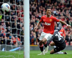 Manchester United's Nani celebrates scoring against Everton during their Premier League match in...