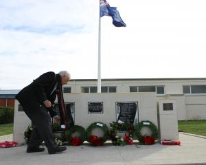 Maniototo RSA president Colin Smith lays a poppy on the Ranfurly War Memorial at Ranfurly on...