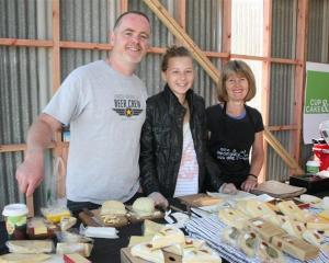 Manning the ever-popular Gibbston Valley Cheese stand at last year's Remarkables Market are (from...