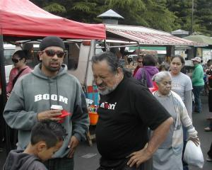 Maori Party co-leader Pita Sharples (centre) meets supporters at the Otara flea market in...