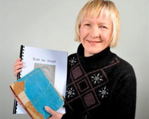 Margaret Pollock (59) with the original version and a digital version of her late father's diary...
