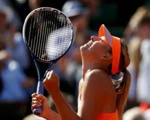 Maria Sharapova celebrates her win over Eugenie Bouchard. REUTERS/Vincent Kessler