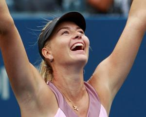 Maria Sharapova of Russia celebrates after defeating Marion Bartoli of France during their women...