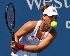 Marina Erakovic of New Zealand hits a return ball to Petra Kvitova of the Czech Republic at the...