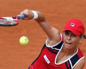 Marina Erakovic serves to Petra Kvitova. REUTERS/Gonzalo Fuentes