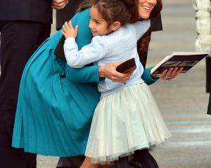 Mataawhio Matahaere-Veint (5) hugs the Duchess of Cambridge at Dunedin International Airport...